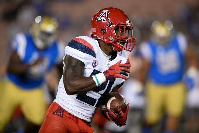 Oct 20, 2018; Pasadena, CA, USA; Arizona Wildcats running back J.J. Taylor (21) runs after a catch during the first half against the UCLA Bruins at Rose Bowl. Mandatory Credit: Kelvin Kuo-USA TODAY Sports