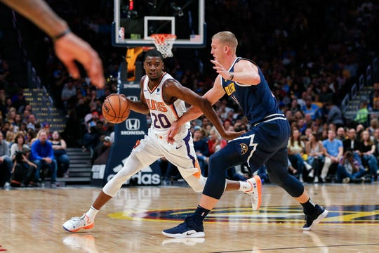 Nuggets forward Mason Plumlee defends Suns forward Josh Jackson during the fourth quarter of a game Saturday.