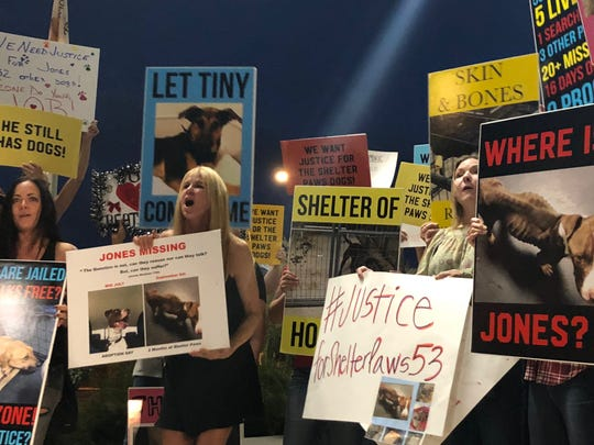 Protesters gathered outside the Maricopa County Sheriff's Office building on Oct. 20, to seek justice for the dogs removed from a Mesa animal shelter.