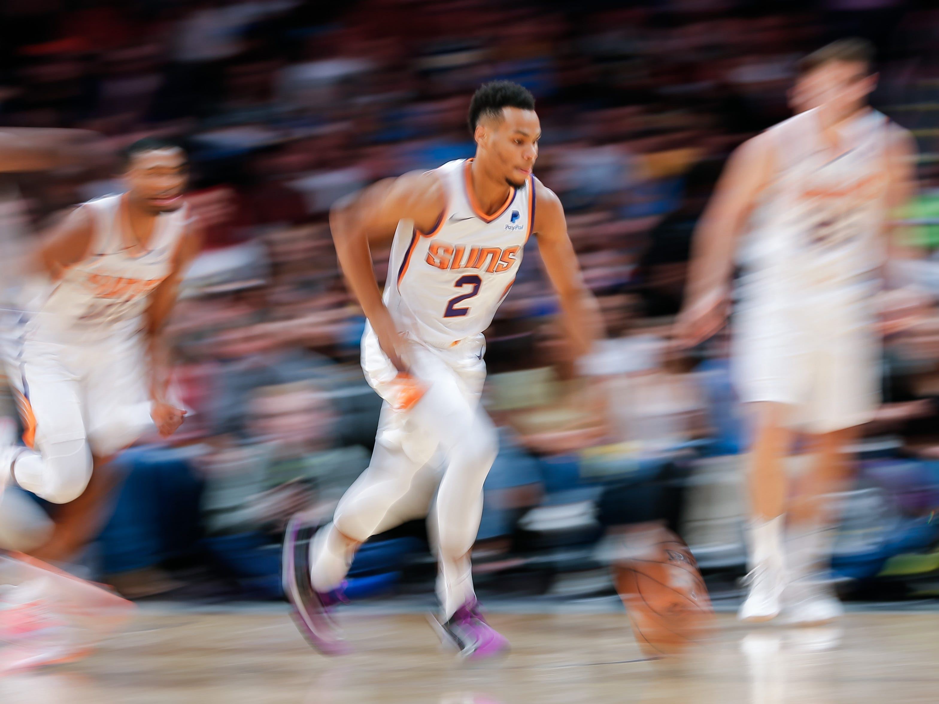 Oct 20, 2018; Denver, CO, USA; Multiple exposure image of Phoenix Suns guard Elie Okobo (2) dribbling the ball up court in the fourth quarter against the Denver Nuggets at the Pepsi Center. Mandatory Credit: Isaiah J. Downing-USA TODAY Sports