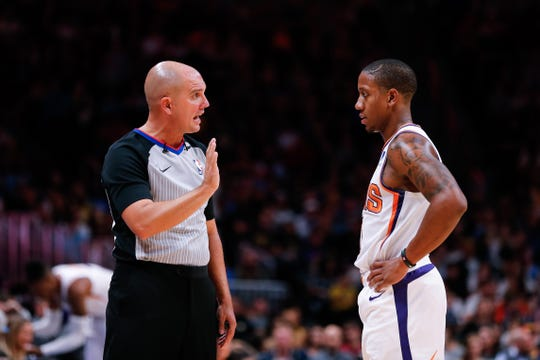 Suns guard Isaiah Canaan talks with referee Jacyn Goble during the second quarter of a game Oct. 20 at the Pepsi Center.