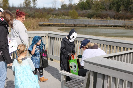 Hundreds of area children got the chance to trick-or-treat through the wilderness and find various costumed characters and learn about the natural wildlife while collecting candy and more.