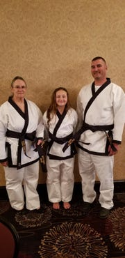Lois, Ryan and Reese Lyle received their black belts in Tang Soo Do on Sunday, Oct. 21, 2018.