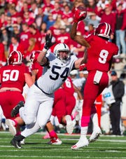Penn State defensive tackle Robert Windsor (54) closes in on Indiana quarterback Michael Penix Jr. (9) in the backfield during the first half of an NCAA college football game Saturday, Oct. 20, 2018, in Bloomington, Ind. (AP Photo/Doug McSchooler)