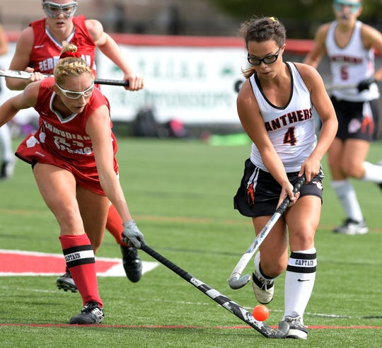 Central York's Breann Craley is challenged by Bermudian Springs' Kayla Pyles in the York-Adams field hockey championship game at Susquehannock High School Saturday, October 20, 2018. Bermudian Springs won in overtime 3-2. Bill Kalina photo