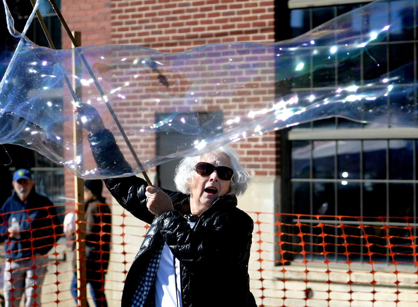Pat Sweetman of York City makes bubbles outside the Agricultural & Industrial Museum during the History On The Half Shell fundraising event sponsored by the York County History Center Sunday, October 21, 2018. The event offered oysters, other food choices, drink, music, children's activities and historical presentations. York's Bubble Lady, Debbie Flaum, provided the bubbles. Bill Kalina photo