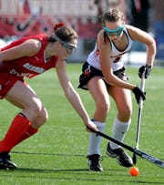 Central York's Grace Harrold maintains possession with  Bermudian Springs' Lillian Peters defending in the York-Adams field hockey championship game at Susquehannock High School Saturday, October 20, 2018. Bermudian Springs won in overtime 3-2. Bill Kalina photo