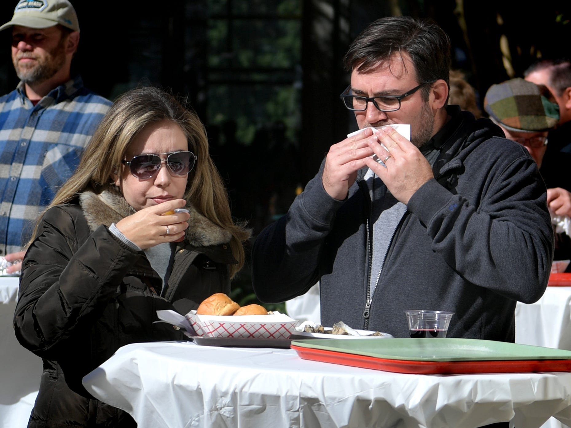 Luis Soares and his wife Erika dine in the courtyard of the Agricultural & Industrial Museum during the History On The Half Shell fundraising event sponsored by the York County History Center Sunday, October 21, 2018. The annual event offered oysters, a variety of food, drink, music, children's activities and historical presentations. Bill Kalina photo