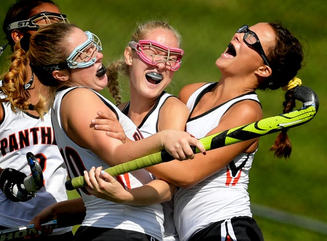 From left, Central York's Kaitlyn Merritt, Kyra Heap and Breann Craley celebrate the team's first goal against Bermudian Springs in the York-Adams field hockey championship game at Susquehannock High School Saturday, October 20, 2018. Bermudian Springs won in overtime 3-2. Bill Kalina photo