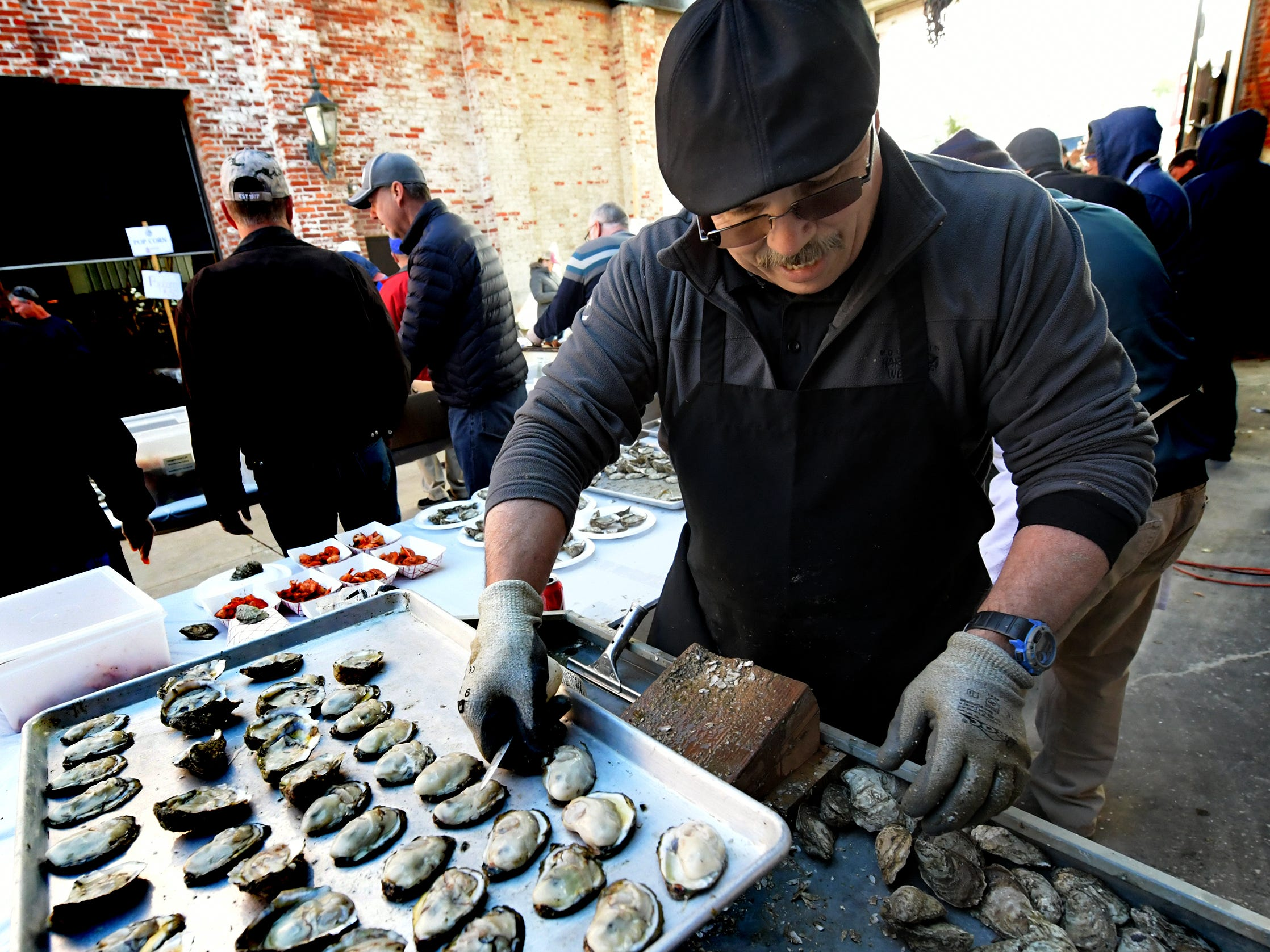 Henry's Seafood employee Henry Thiess shucks oysters at the Agricultural & Industrial Museum during the History On The Half Shell fundraising event sponsored by the York County History Center Sunday, October 21, 2018. The annual event offered oysters, a variety of food, drink, music, children's activities and historical presentations. Bill Kalina photo