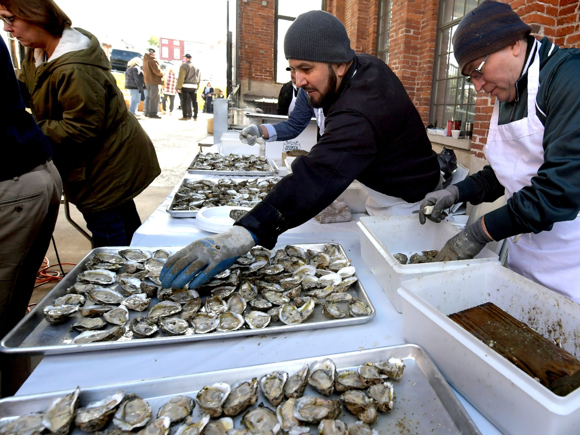 Henry's Seafood employees Miguel Bergara, left, and Joe Machado shuck oysters at the Agricultural & Industrial Museum during the History On The Half Shell fundraising event sponsored by the York County History Center Sunday, October 21, 2018. The annual event offered oysters, a variety of food, drink, music, children's activities and historical presentations. Bill Kalina photo
