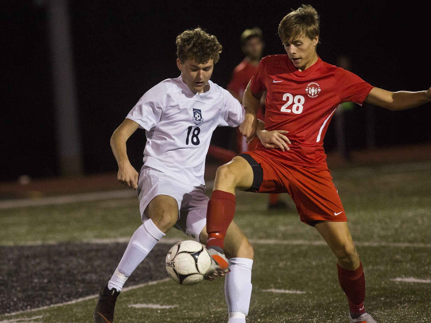 West York's Aidan Clark, left, and Susquehannock's Nathan Weldon compete for the ball. Susquehannock plays West York in the YAIAA boys' soccer championship game at Northeastern High School in Manchester, Saturday, October 20, 2018.