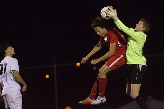 West York goalkeeper Connor Gerrick, right, makes a save. Susquehannock plays West York in the YAIAA boys' soccer championship game at Northeastern High School in Manchester, Saturday, October 20, 2018.