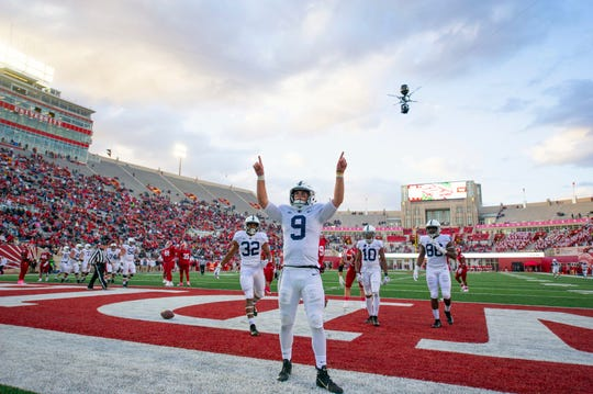 Penn State quarterback Trace McSorley (9) reacts in the end zone after scoring during the second half of an NCAA college football game against Indiana Saturday, Oct. 20, 2018, in Bloomington, Ind. Penn State won 33-28.