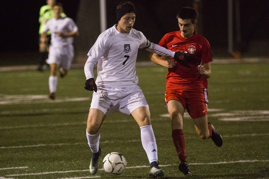 West York's Jake Altimore, left, and Susquehannock's Nolan Holloway compete for the ball. Susquehannock plays West York in the YAIAA boys' soccer championship game at Northeastern High School in Manchester, Saturday, October 20, 2018.