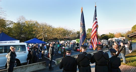 There was a moment of silence to remember first responders and officers killed in the line of duty, during the opening ceremony of the York County Sheriff's Office Second Annual K-9 Unit Fundraiser and Fall Event at Rudy Park Sunday. The York City Police Honor Guard is in the foreground.