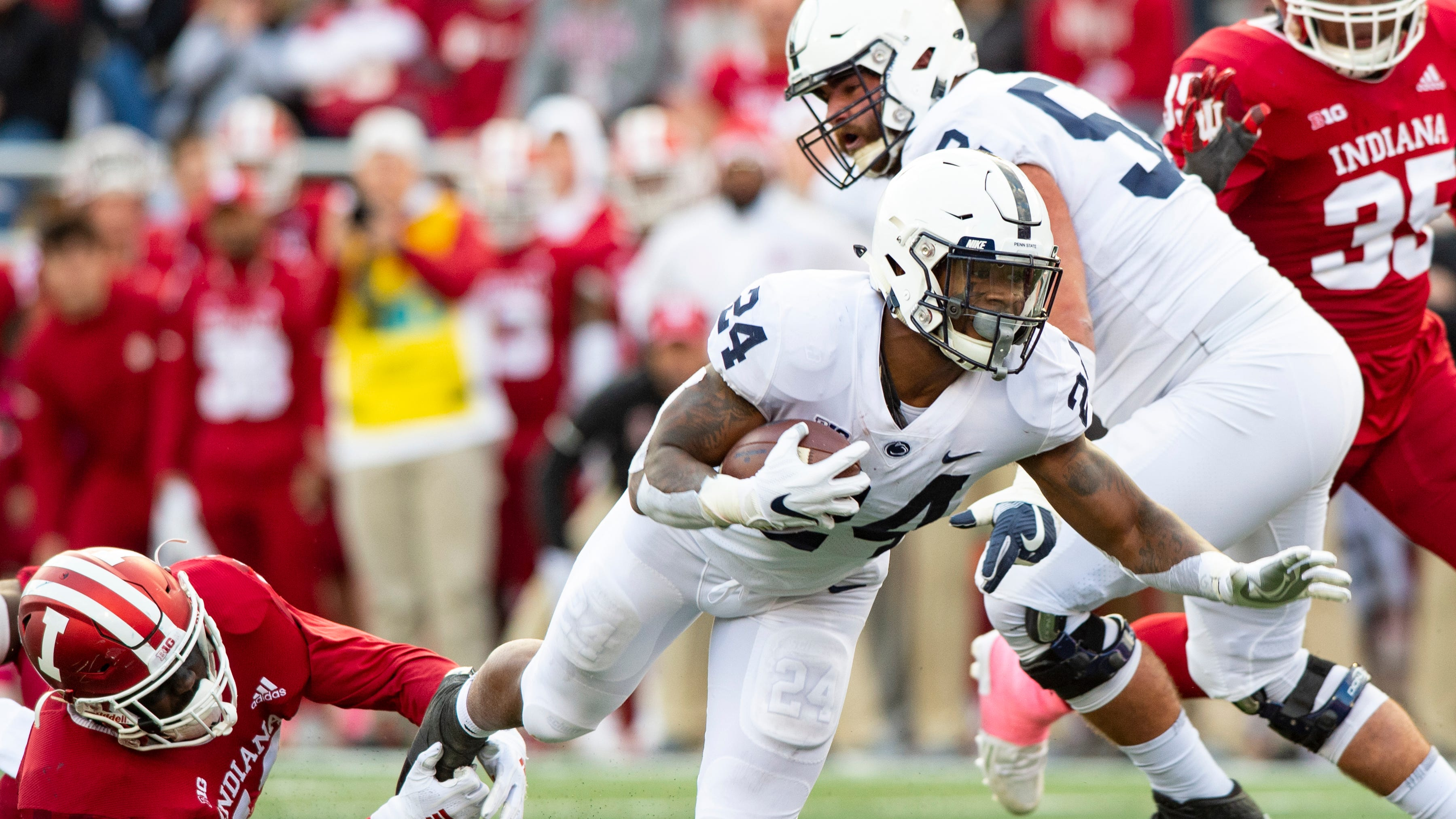 Penn State running back Miles Sanders (24) is tripped up by Indiana linebacker Dameon Willis Jr. (43) as he rushes the ball up field during the second half of an NCAA college football game Saturday, Oct. 20, 2018, in Bloomington, Ind. Penn State won 33-28.