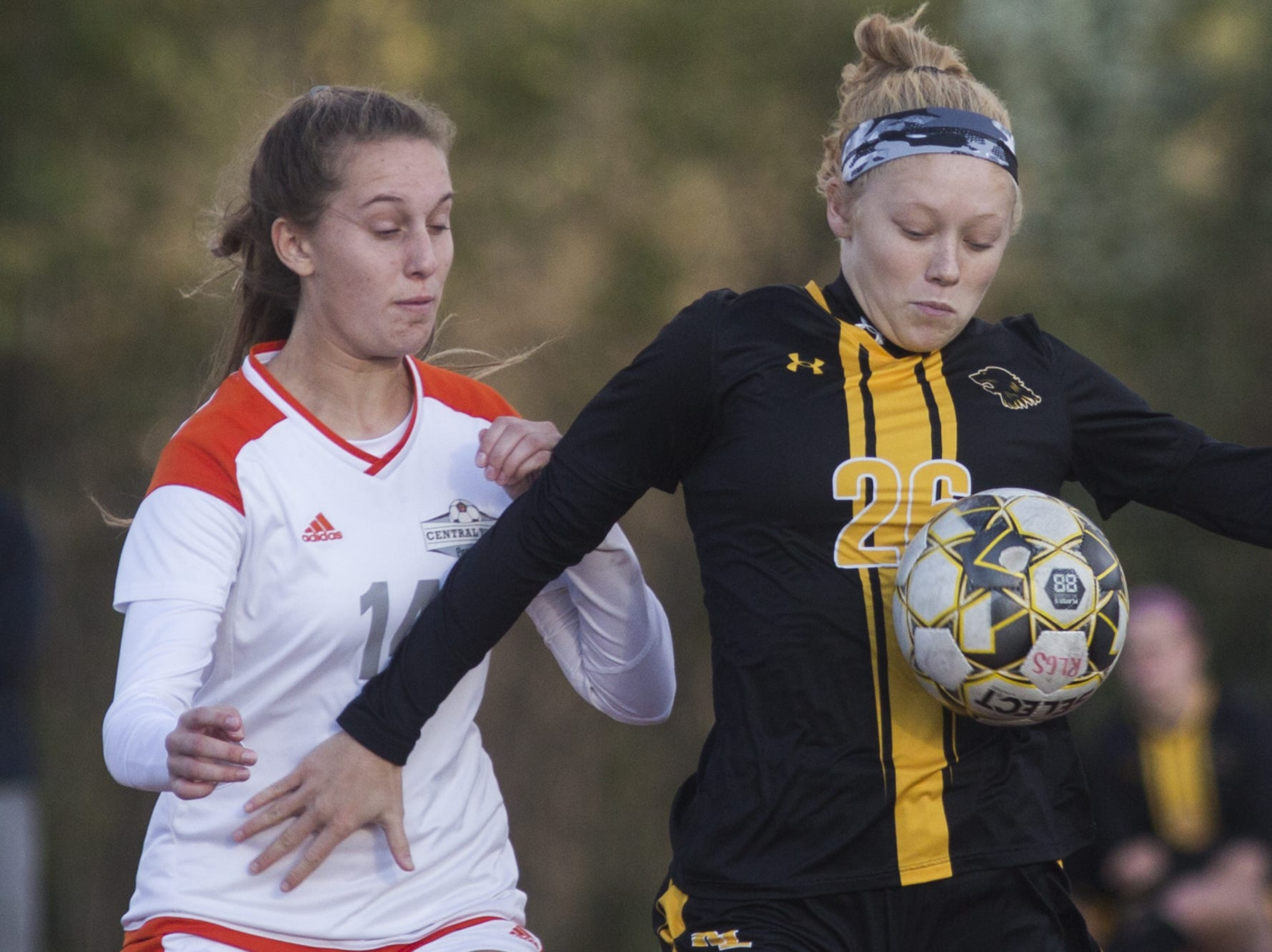 Central York's Abby Grigg, left, and Red Lion's Paige Frey compete for the ball. Central York defeats Red Lion 1-0 in the YAIAA girls' soccer championship game at Northeastern High School in Manchester, Saturday, October 20, 2018.