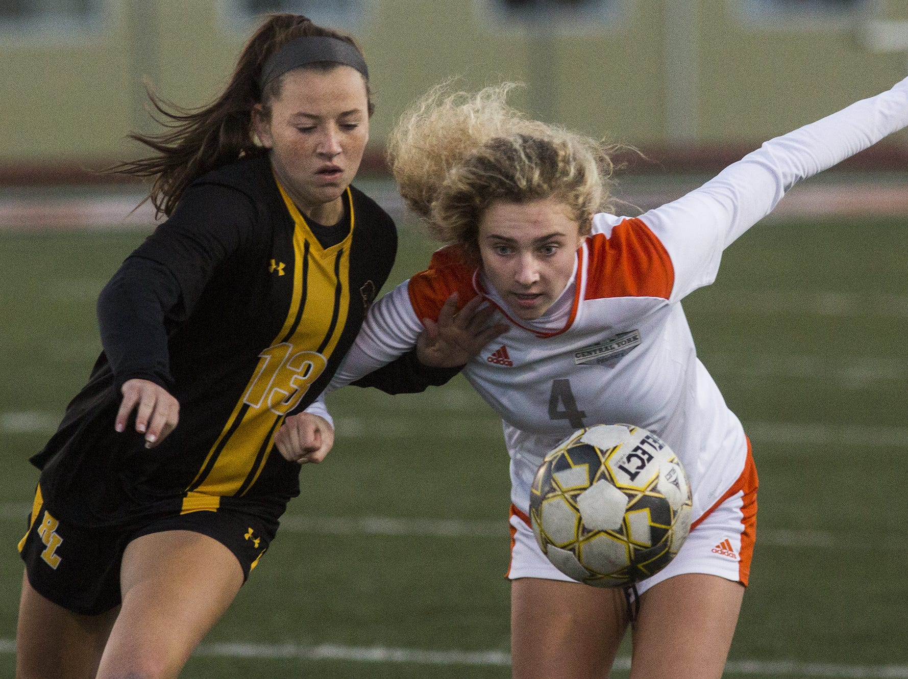 Red Lion's Julia Rowe, left, and Central York's Anya Schnetzka compete for the ball. Central York defeats Red Lion 1-0 in the YAIAA girls' soccer championship game at Northeastern High School in Manchester, Saturday, October 20, 2018.