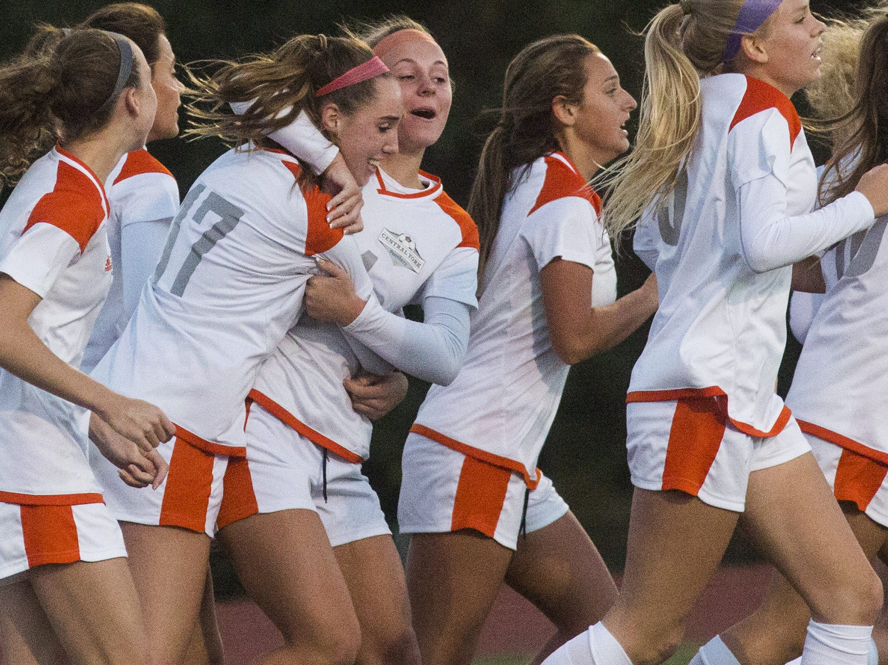 Central York's Katelyn Mair, third from left, gets a hug from her teammate, Madi Davis, center, after Mair scored the game's only goal. Central York defeats Red Lion 1-0 in the YAIAA girls' soccer championship game at Northeastern High School in Manchester, Saturday, October 20, 2018.