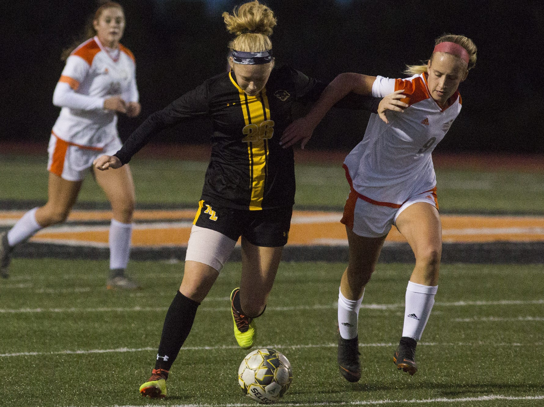 Red Lion's Paige Frey, left, and Central York's Sydney Koncsol compete for the ball. Central York defeats Red Lion 1-0 in the YAIAA girls' soccer championship game at Northeastern High School in Manchester, Saturday, October 20, 2018.