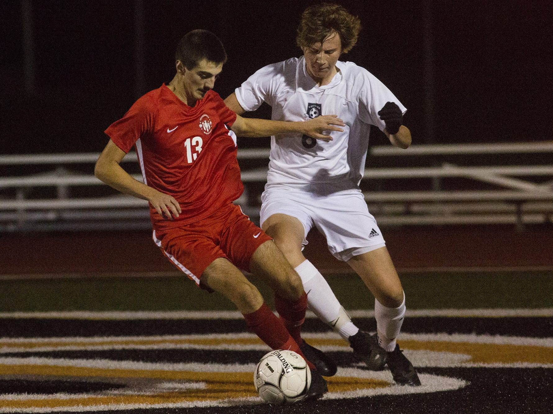 Susquehannock's Nolan Holloway, left, and West York's Jack Langstaff compete for the ball. Susquehannock plays West York in the YAIAA boys' soccer championship game at Northeastern High School in Manchester, Saturday, October 20, 2018.