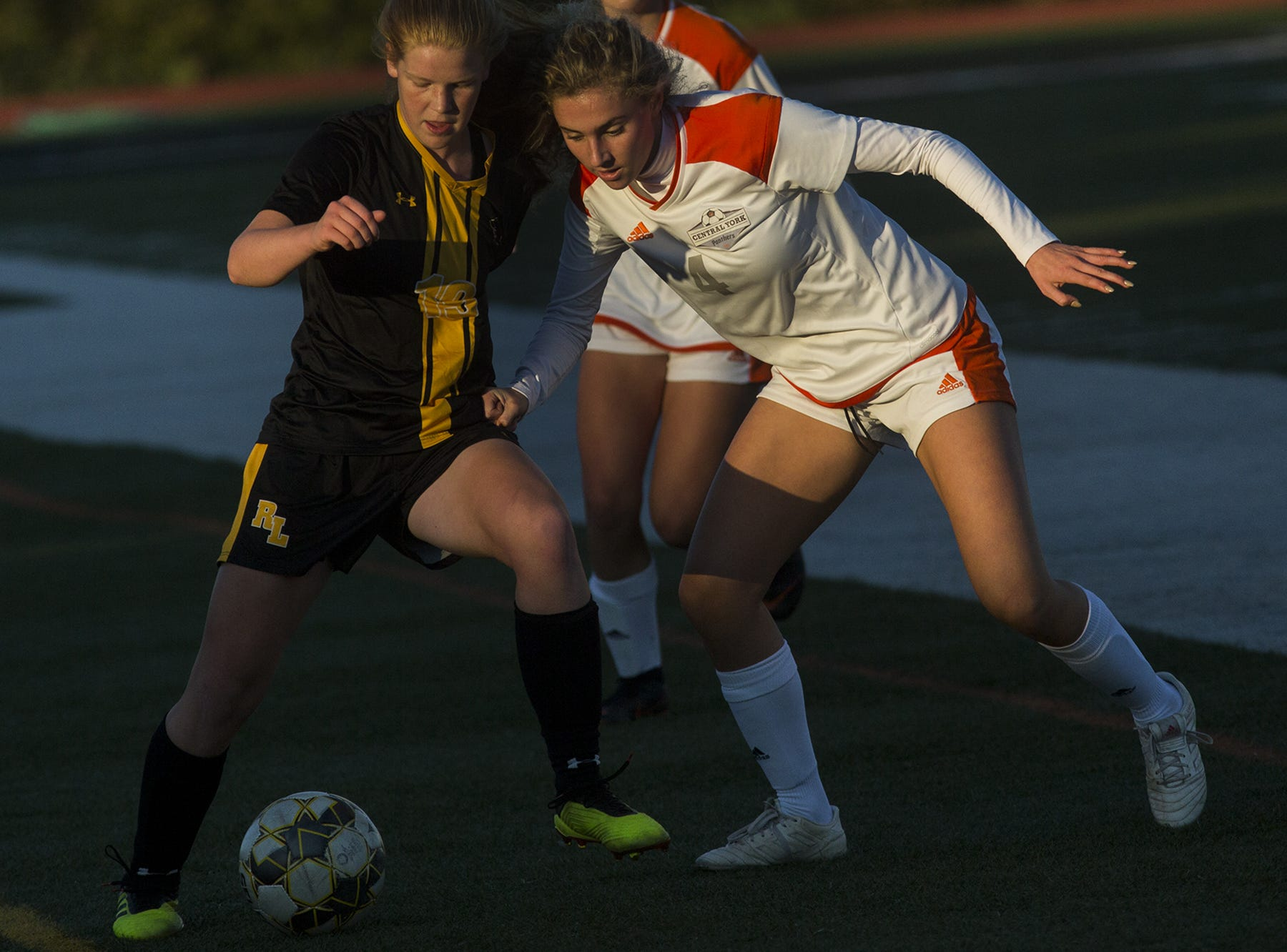 Red Lion's Anna Gatchell, left, and Central York's Anya Schnetzka compete for the ball. Central York defeats Red Lion 1-0 in the YAIAA girls' soccer championship game at Northeastern High School in Manchester, Saturday, October 20, 2018.