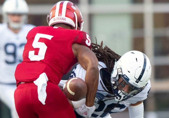 Penn State safety Jonathan Sutherland (26) knocks the ball away from Indiana wide receiver J-Shun Harris II (5) setting up a fumble recovery by Penn State during a punt return in the second half of an NCAA college football game Saturday, Oct. 20, 2018, in Bloomington, Ind. Penn State won 33-28.