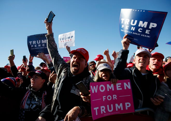 The audience cheers as President Donald Trump arrives at Elko Regional Airport, Saturday, Oct. 20, 2018, in Elko, Nv., for a campaign rally. (AP Photo/Carolyn Kaster)