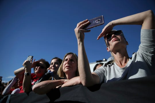 People listen to former Vice President Joe Biden as he speaks during a Nevada State Democratic Party rally to promote voting at the Culinary Workers Union Local 226 headquarters in Las Vegas, Saturday, Oct. 20, 2018. (Erik Verduzco/Las Vegas Review-Journal via AP)