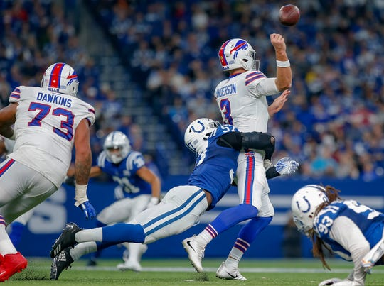INDIANAPOLIS, IN - OCTOBER 21: Kemoko Turay #57 of the Indianapolis Colts puts the hit on Derek Anderson #3 of the Buffalo Bills causing a fumble and turnover during the game at Lucas Oil Stadium on October 21, 2018 in Indianapolis, Indiana. (Photo by Michael Hickey/Getty Images)