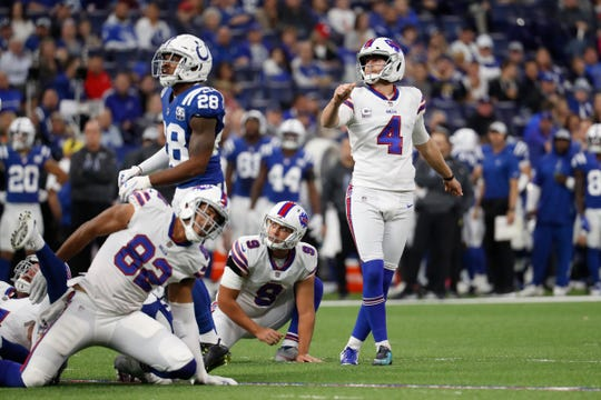 Buffalo Bills kicker Stephen Hauschka (4) kicks a field goal fro the hold of Corey Bojorquez in the second half of an NFL football game against the Indianapolis Colts in Indianapolis, Sunday, Oct. 21, 2018. (AP Photo/John Minchillo)