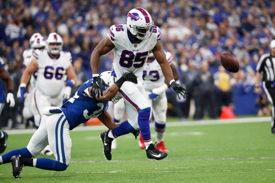 Buffalo Bills tight end Charles Clay (85) fumbles as he is hit by Indianapolis Colts defensive back Mike Mitchell (34) during the first half of an NFL football game in Indianapolis, Sunday, Oct. 21, 2018. (AP Photo/John Minchillo)