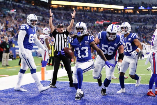 Indianapolis Colts wide receiver T.Y. Hilton (13) celebrates a touchdown catch against the Buffalo Bills during the first half of an NFL football game in Indianapolis, Sunday, Oct. 21, 2018. (AP Photo/John Minchillo)