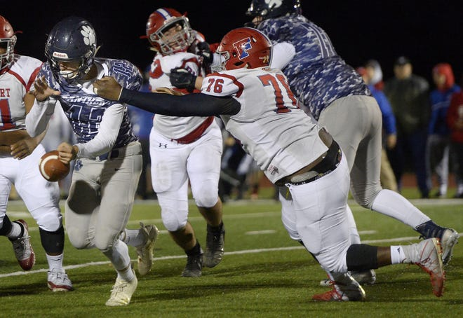 Fairport's Onome Kessington, right, strips the ball from Pittsford's Matt LaRocca. Fairport returned the fumble for a  touchdown during a Section V Class AA quarterfinal on Oct. 20, 2018.