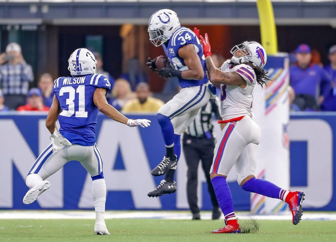INDIANAPOLIS, IN - OCTOBER 21: Mike Mitchell #34 of the Indianapolis Colts makes an interception in front of Kelvin Benjamin #13 of the Buffalo Bills at Lucas Oil Stadium on October 21, 2018 in Indianapolis, Indiana. (Photo by Michael Hickey/Getty Images)