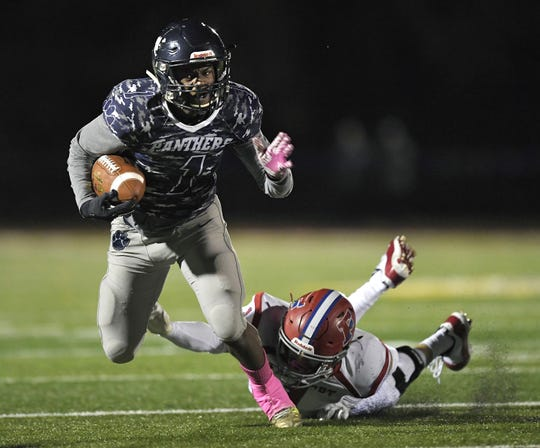 Pittsford's Lavontae Bonds, left, is tripped up by Fairport's Gavin Carlson during a Class AA sectional quarterfinal played at Pittsford Sutherland High School, Saturday, Oct. 20, 2018.
