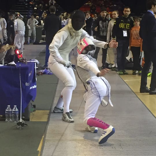 Taylor Sartori of Rochester Fencing Club in pink and front against Lila Breard of Club Nantes BEC, France in Paris, February, 2018