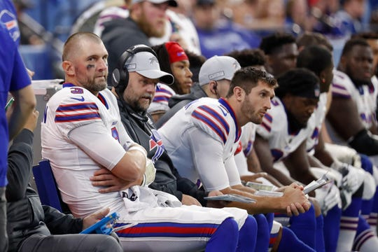 Buffalo Bills offensive coordinator Brian Dabioll, second from left, sits between quarterbacks Derek Anderson (3) and Nathan Peterman (third from left) on on the bench in the closing minutes of the Bills' 37-5 loss to the Indianapolis Colts on Sunday.
