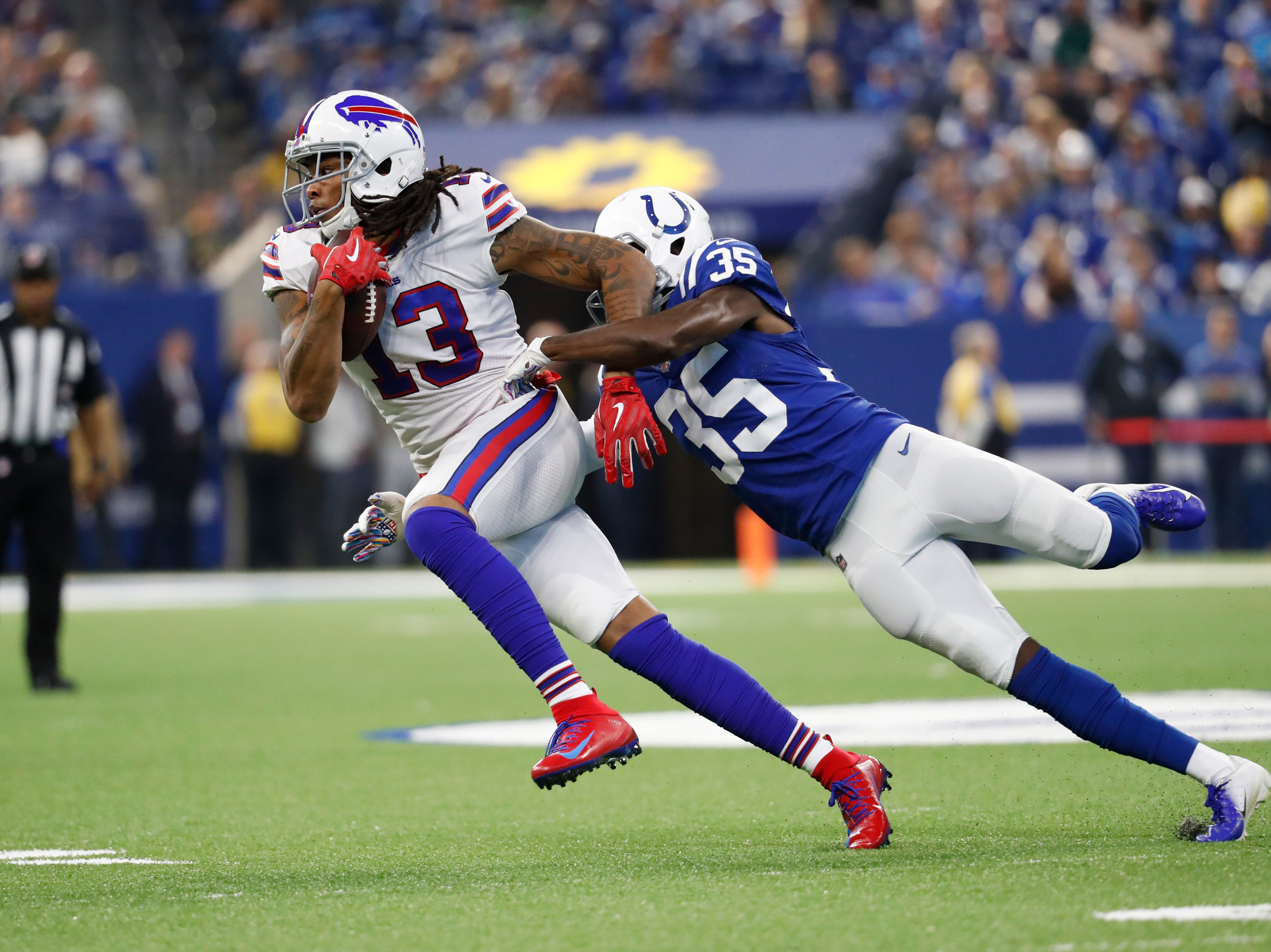 Indianapolis Colts defensive back Pierre Desir (35) tackles Buffalo Bills wide receiver Kelvin Benjamin (13) during the first half of an NFL football game in Indianapolis, Sunday, Oct. 21, 2018. (AP Photo/John Minchillo)