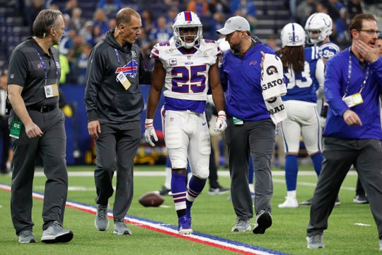 Buffalo Bills running back LeSean McCoy (25) is assisted off the field after being injured during the first half of an NFL football game against the Indianapolis Colts in Indianapolis, Sunday, Oct. 21, 2018. (AP Photo/John Minchillo)