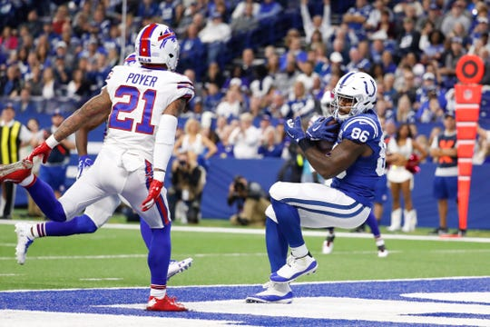 Indianapolis Colts tight end Erik Swoope (86) makes a catch for a touchdown in front of Buffalo Bills free safety Jordan Poyer (21) during the first half of an NFL football game in Indianapolis, Sunday, Oct. 21, 2018. (AP Photo/John Minchillo)