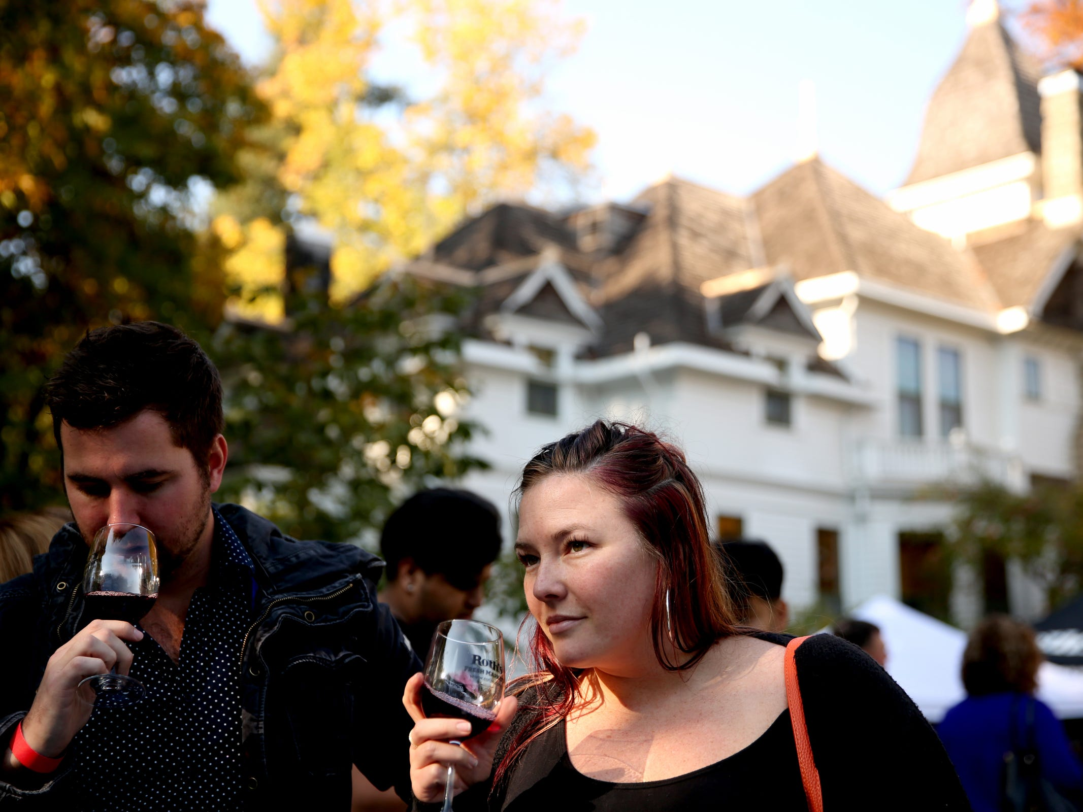 Amanda and Curtis Twenge, of Newberg, taste wine during the Wine & Jazz Festival at Deepwood Museum & Gardens in Salem on Sunday, Oct. 21, 2018.
