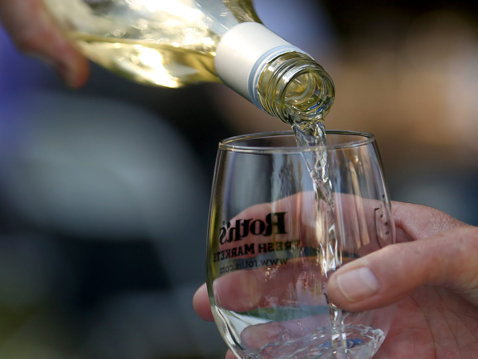 Wine is poured for tastings during the Wine & Jazz Festival at Deepwood Museum & Gardens in Salem on Sunday, Oct. 21, 2018.