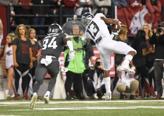 Oct 20, 2018; Pullman, WA, USA; Oregon Ducks wide receiver Dillon Mitchell (13) makes a catch in from of Washington State Cougars safety Jalen Thompson (34) in the second half at Martin Stadium. The Cougars won 34-20. Mandatory Credit: James Snook-USA TODAY Sports