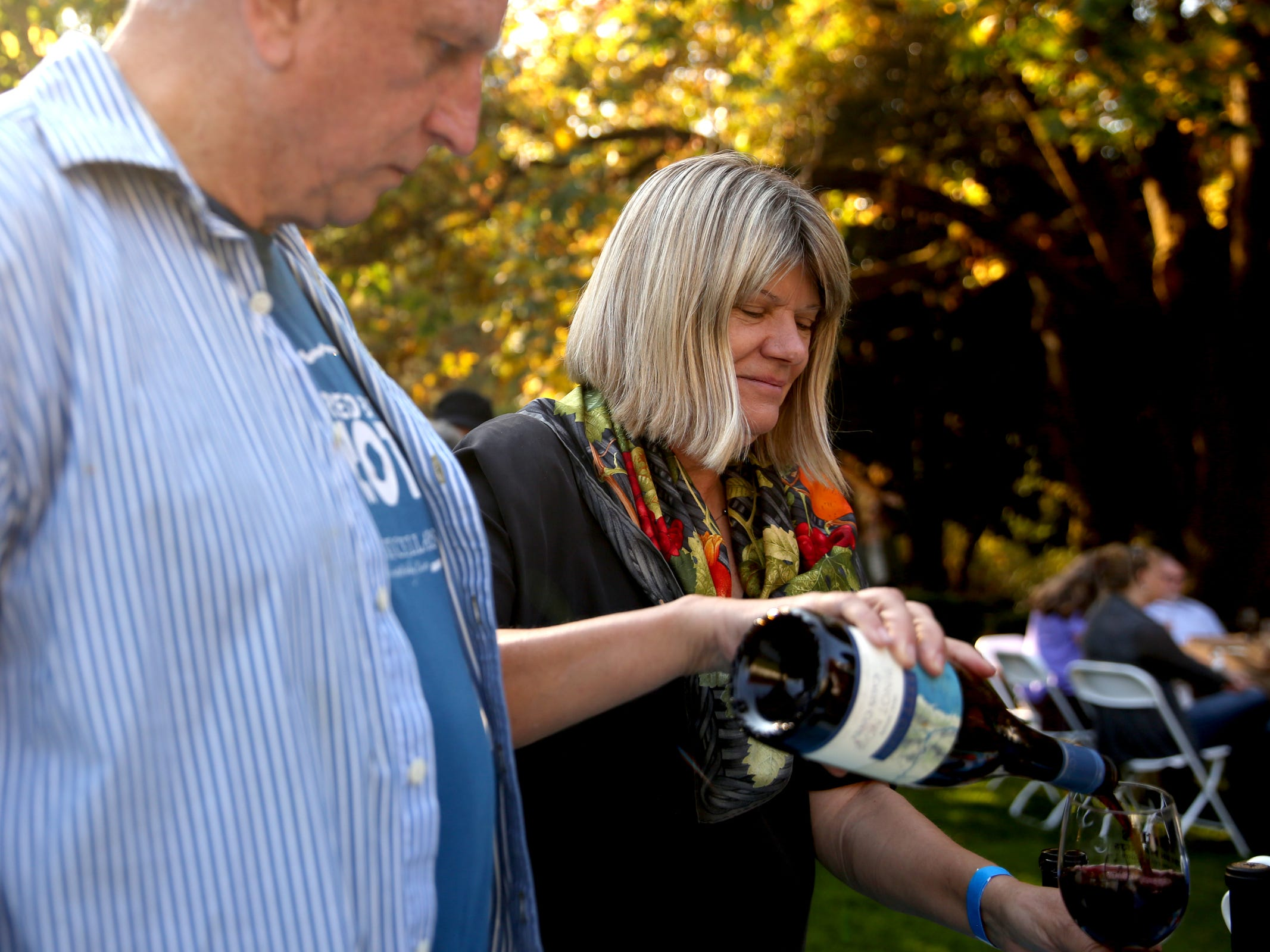 Suzanne Larson and her husband Bob Pfaff, the founders of Left Coast Estate, pour a wine tasting during the Wine & Jazz Festival at Deepwood Museum & Gardens in Salem on Sunday, Oct. 21, 2018.