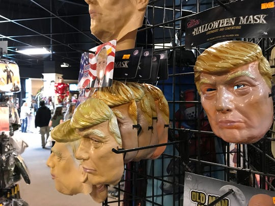 Masks of President Donald Trump are sold at the Halloween Express pop-up store in Sioux Falls.