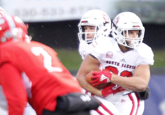 South Dakota's Ben Klett runs with the ball during the first half of their game against Youngstown State at Stambaugh Stadium on Saturday. EMILY MATTHEWS | THE VINDICATOR