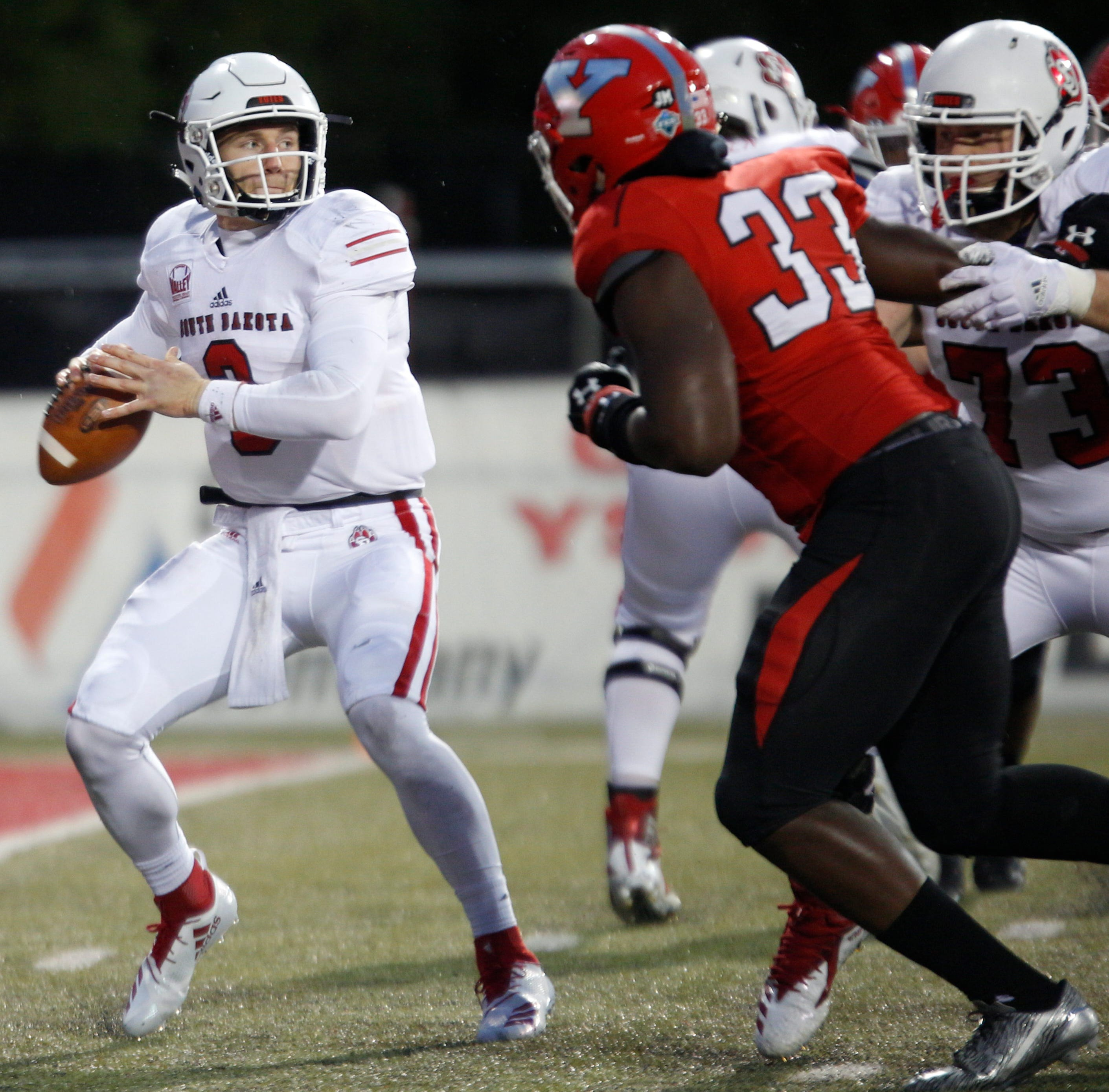 South Dakota's Austin Simmons gets ready to throw the ball during the first half of their game against Youngstown State at Stambaugh Stadium on Saturday. EMILY MATTHEWS | THE VINDICATOR