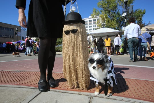 These Pets and Pumpkins attendees came as the Addams Family.